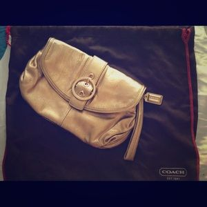COACH small gold leather clutch